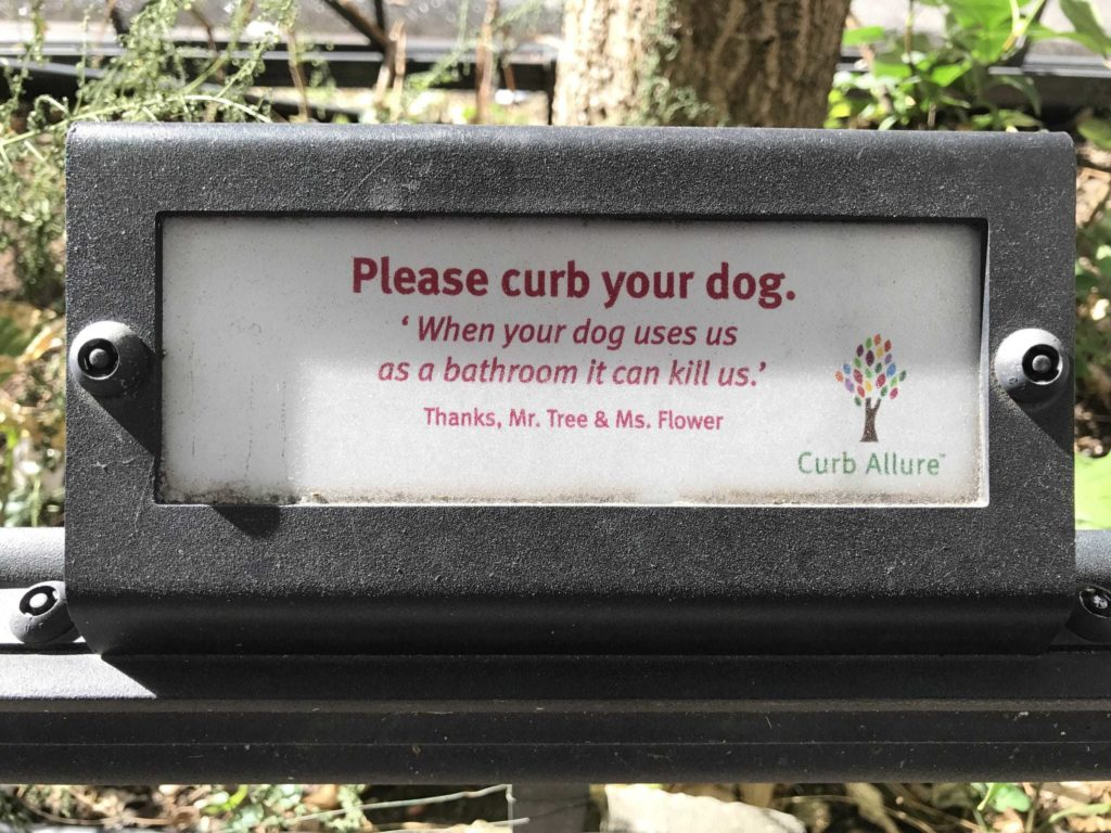 "Sign that says: ""Please curb your dog. When your dog uses us as a bathroom it can kill us."" From Curb Allure"