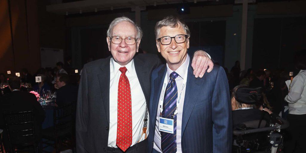 Two people standing: Warren Buffett and Bill Gates
