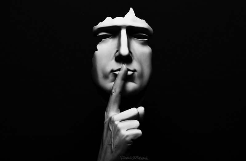 Shhh! Man with finger on lips
