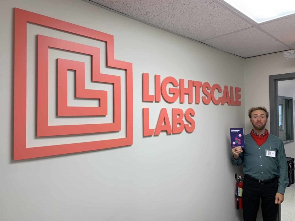 Lightscale Labs sign and me in corner holding terpenes brochure