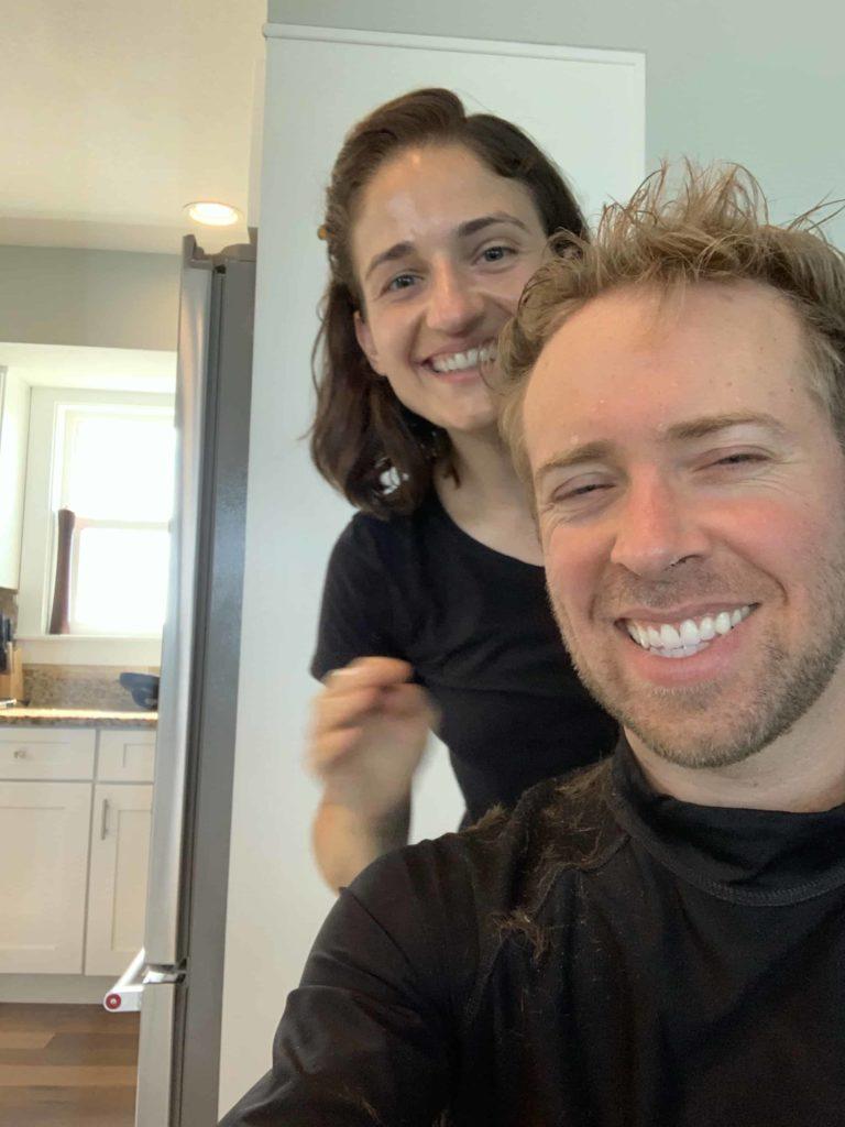 Nick and Rachel smiling during quarantine haircut