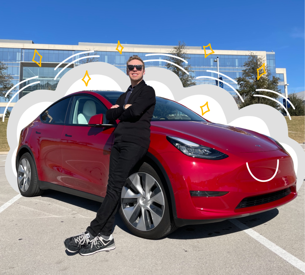Nick Gray standing in front of a Tesla Model Y that is red in color, with some cartoon-ish effects added around the car